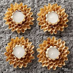These are pistachio shells! To make your own flowering set of votive holders, cut a circle from a piece of cardboard. Hot-glue pistachio shells around the edge of the cardboard, pointing the shells slightly upward. Hot-glue a second row of shells ou Easy Fall Crafts, Fall Crafts For Kids, Diy And Crafts, Arts And Crafts, Kids Diy, Decor Crafts, Shell Candles, Diy Candles, Pista Shell Crafts