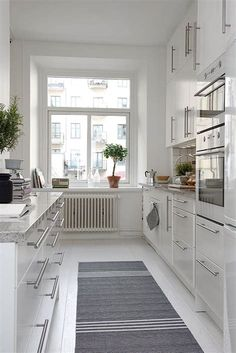 open galley kitchen Galley Kitchen Remodel Ideas - A galley kitchen is a household kitchen design which consists of two parallel runs of units. Open Galley Kitchen, White Galley Kitchens, Galley Kitchen Design, Galley Kitchen Remodel, New Kitchen, Kitchen White, Kitchen Ideas, Kitchen Remodeling, Remodeling Ideas