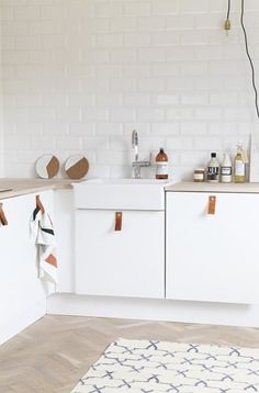 white cabinets with leather pulls / milk magazine