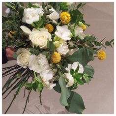 Med inspired bridal bouquet with pops of yellow | phalaenopsis, craspedia, roses, freesias and eucalyptus