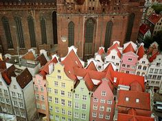 Viewed from the Main Town Hall, the Gothic façade of St. Mary's -- the world's largest brick church -- looms above neighboring buildings in Gdańsk, a thousand-year-old seaport on Poland's Baltic coast that has been ruled in turns by Teutonic Knights, Prussians, Germans, and Poles.