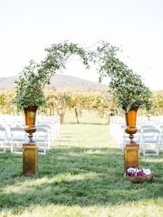 Romantic autumn ceremony arch: http://www.stylemepretty.com/virginia-weddings/rivanna-virginia/2016/01/19/elegant-autumn-virginia-vineyard-wedding/ | Photography: Rachel May - http://www.rachel-may.com/