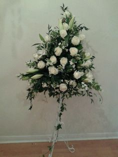 Ivory rose, phlox and lilly pedastal arrangement.