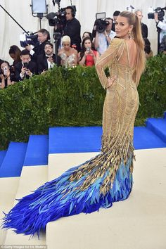 Va-va-voom: The California girl turned to show off her toned backside in the formfitting Versace gown
