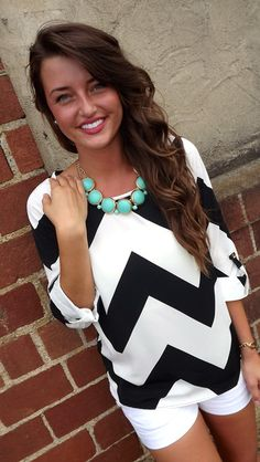 This black/white chevron printed blouse with turquoise necklace is just lovely!