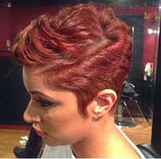 Cherry color short hairstyle with front flipped and shaped sideburns