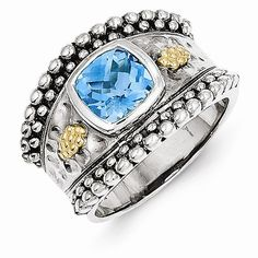 A Sterling Silver Gold Blue Topaz Ring jewelryshopping.com