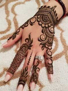 Mehndi henna designs are always searchable by Pakistani women and girls. Women, girls and also kids apply henna on their hands, feet and also on neck to look more gorgeous and traditional. Henna Hand Designs, Eid Mehndi Designs, Pretty Henna Designs, Mehndi Designs Finger, Modern Mehndi Designs, Mehndi Designs For Girls, Mehndi Design Pictures, Beautiful Mehndi Design, Henna Tattoo Designs
