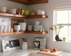 Wrap around corner shelves... so cute and would help get rid of all the clutter I shove in the back of my cabinets!