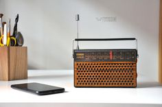 This is an old Schaub Lorenz Vintage radio converted to a Bluetooth speaker. With this retro radio now you can listen to music via your Smartphone, iPhone, laptop or any other Bluetooth enabled device. So cool!