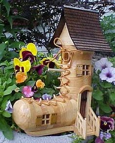 'old woman who lived in a shoe' bird house.....she had so many birdies she didn't know what to do....;}