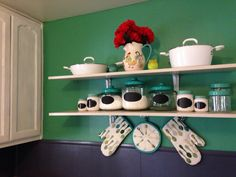 Turquoise, White and Gray Kitchen budget remodel (we rent)! The paint was all oops colors and the Shelves $6 ea from Home Depot, Oven Mits & Towels from Target 70% off clearance, Pampered Chef Cookware (I am a consultant), the remaining glass and ceramic containers and decor are from Michael's all items were 40%off plus an additional 20% off.