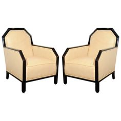 These luxurious chairs epitomize the glamour of the Art Deco era in France. They are black lacquered with fluted detailing on the legs and skyscraper style detailing on the back.They have been newly upholstered in a Shagreen fabric. France, 1930