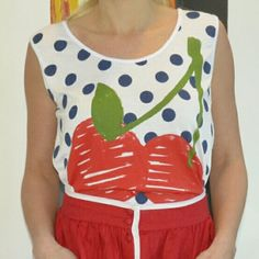 """🍒 🆕 """"With a cherry on top"""" top NWT Brand new with tags """"Pretty please with a cherry on top"""" Top. Adorable ties on each side. Vibrant red cherries with navy blue polka dots on front, back is white. Pair with fabulous skirt and heels or shorts and sandals, crop  Length approx 18"""" Bust approx 18"""" side to side  No material tag attached. Tops"""