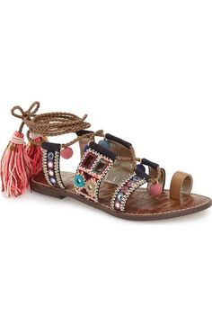 Sam Edelman 'Gretchen' Embellished Lace-Up Sandal. Lively string tassels ornamented with tiny goldtone charms tip the woven wraparound laces of a boho-chic toe-loop sandal further brightened by mixed geo embroidery & colorful pompom accents.