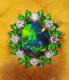 Dreamtime Jewelry: Black Opal, demantoid garnet, and diamond Ring