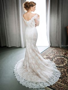Kenneth Winston Style 1699 | all-over corded embroidery lace wedding dress with sheer sleeve and wide neckline | luxurious bridal gown