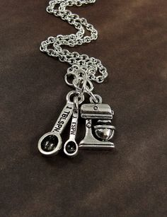 Bakers Kitchen Mixer and Measuring Spoons Necklace, Silver Baking Charms on a Silver Cable Chain. $14.00, via Etsy.