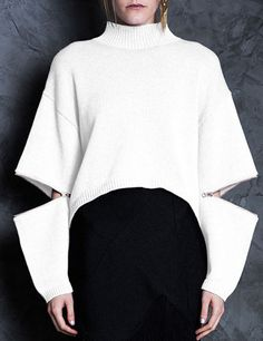 Rice white cropped knit jumper with rose gold zippers. Oversized, cropped knit jumper. Features fully functioning zips through middle of sleeves, a curved...