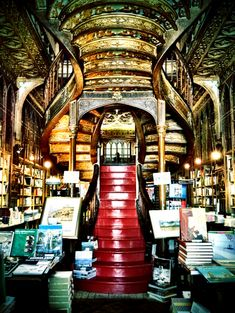 I HAVE to go here>>> The Harry Potter Bookstore -- Lello Bookstore in Porto, Portugal.  This architecture inspired J.K. Rowling when she dreamed about Hogwarts!