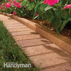 Using bricks to create a border around flower beds