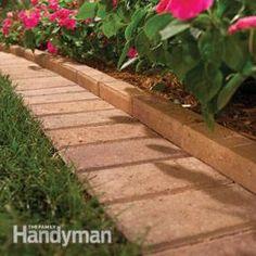 Using bricks to create a border around flower beds