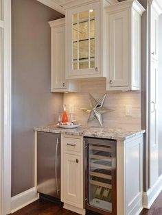 Small wet bar with icemaker, small (wine?) fridge, and locking cabinet for liquor. Maybe an additional lower cabinet for mugs and coffee-related stuff because I'd do open shelves above, not cabinets, for pretty glassware. Also would want a bar sink and room for coffee equipment, so like this photo, but bigger.
