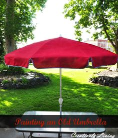 """Painting your Old Umbrella - turn a faded outdoor umbrella into a """"new"""" umbrella with spray paint & ribbon trim"""