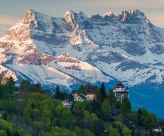 Morning in the Swiss Alps. In the first plan Castle in Caux with Les Dents du Midi in the second plan. Photo by Florin Biscu -- National Geographic Your Shot Beautiful Hotels, Beautiful World, Places In Europe, Places To Go, Wonderful Places, Beautiful Places, Amazing Places, Glacier National Park Montana, Heart Of Europe