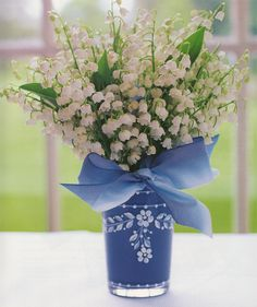 Lily of the Valley bouquet in a blue vase, with a blue bow - image from 'A Passion for Blue and White' by Carolyne Roehm (for sale here: www.amazon.com/gp/product/0767921135/ )