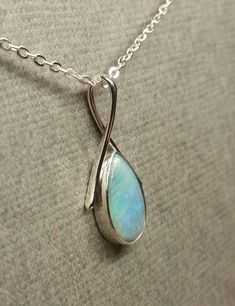 Blue lightning Ridge Opal set into a Sterling silver hand forged pendant.