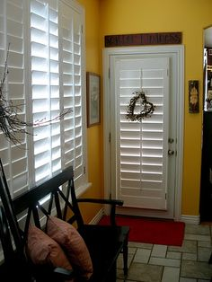 Hmmmm . . . nerver thought about using plantation shutters for the back door.