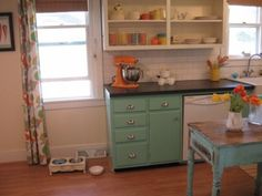 Vintage, eclectic girl's kitchen. Highlights: color palette, hardware, paper stone countertop, shabby chic cabinet paint, and warm hardwood floors.