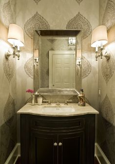 Powder Room / Half Bath, looking at these lamps as mirror covers wall above sink