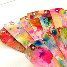 mail art tags - I think this is just paint w/extra water & paper towels to make texture