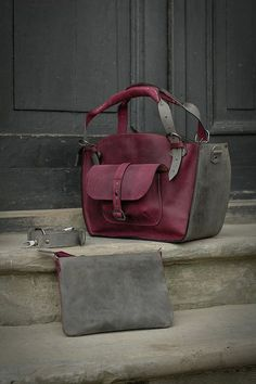 Very nice set- shoulder zippered bag and zippered envelope clutch. Bag has a long detachable shoulder strap You can order this bag in different colours-