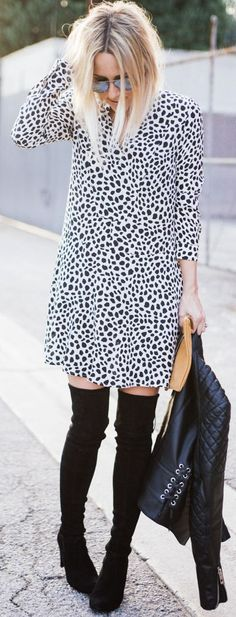 White And Black Bold Print Drop-waist Silhouette Mini Dress with black thigh high boots.
