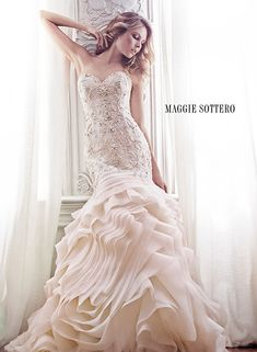 Maggie Sottero has her spring 2015 line out!  This is the Aurora gown.  Description: Venice organza is artfully draped into this luxurious fit and flare wedding dress, featuring a decadent embroidered bodice with Swarovski crystals and romantic sweetheart neckline. Finished with crystal button over zipper and inner elastic closure.  Colors Available: White, Ivory (shown), Soft Blush