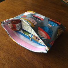 Large reusable snack bag!  Fits a box of cereal, granola bar, and tuna pouch perfectly!