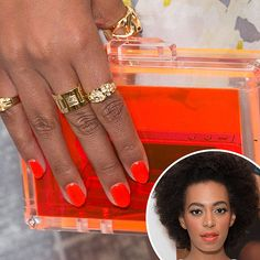 Solange Knowles: Always a fan of bright colors, Solange Knowles went for a fiery tangerine shade on lips and nails at one of her performances.