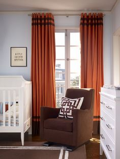 Pastel Blue Walls with Orange Curtains and the Luca Glider.