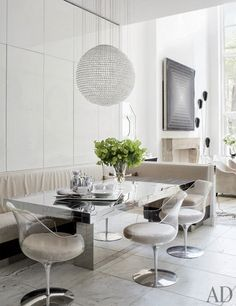 "Elle Decor. ""In the kitchen dining area, the table by Paul Evans is  accompanied by a Pamplemousse Design banquette, upholstered in Holly Hunt  fabric, ..."