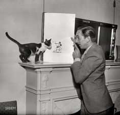 Washington, D.C., circa 1931. Walt Disney with Mickey Mouse drawing.