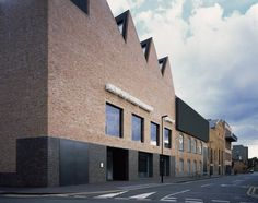 Damien Hirst's Gallery This private gallery in Vauxhall  has involved the conversion of an extraordinary terrace of listed industrial buildings, that were formerly theatre carpentry and scenery painting workshops. By Caruso St John Architects