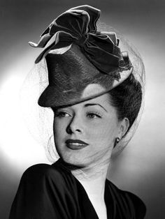 Eleanor Parker Wearing a Tall Crowned Chapeua Made of Felt with Velvet Bows, 1943