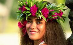 A Tahitian woman in traditional headdress