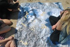 Playing Bananagrams on the Ice and Snow Blanket Design by Studio Run Design. Its a blanket that is inspired by the Canadian Winter Landscape. A great addition to the beach, or for the home.