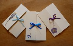 Homemade wedding invitations with pressed flowers and ribbons