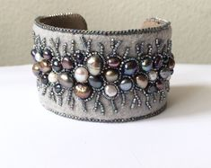 Bracelets Embroidery Grey bead embroidery bracelet freshwater pearl cuff Winter lace in grey and silver Bead Embroidered Bracelet, Embroidery Bracelets, Beaded Cuff Bracelet, Bead Embroidery Jewelry, Beaded Embroidery, Cuff Bracelets, Embroidery Stitches, Embroidery Patterns, Bead Embroidery Tutorial