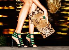Oversize leopard clutch looks great with shoes and ring.